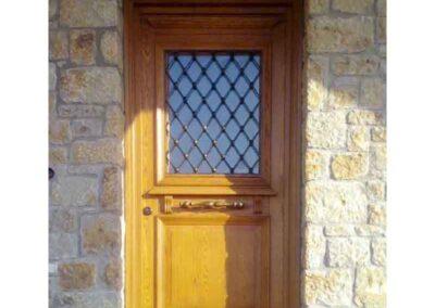 Μονόφυλλη εξωτερική πόρτα ταμπλαδωτή από ξυλεία Δρυς Αμερικής